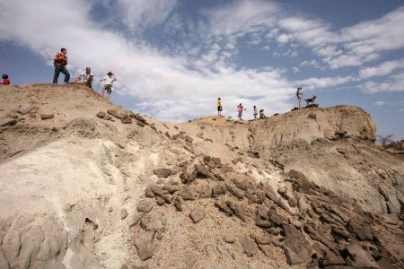 TBI Field School students stand above Pliocene sediments outside camp in Turkana, NW Kenya.