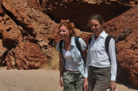 Marsha and Ebba, visiting archaeologists from Sweden, pause while walking up the Nawata streambed at Lothagam.
