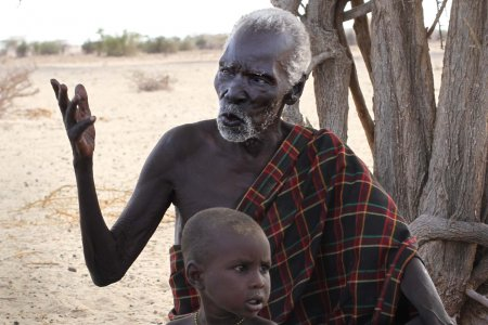Eporon and his grandchild outside their home in south Turkwel.