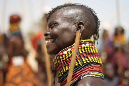 A Turkana woman smiles during a wedding ceremony's festivities.