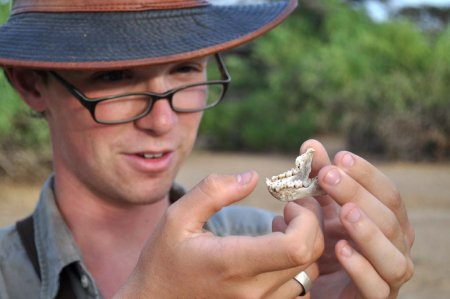 Ben finds a vervet mandible in the shrubland outside TBI's main camp.